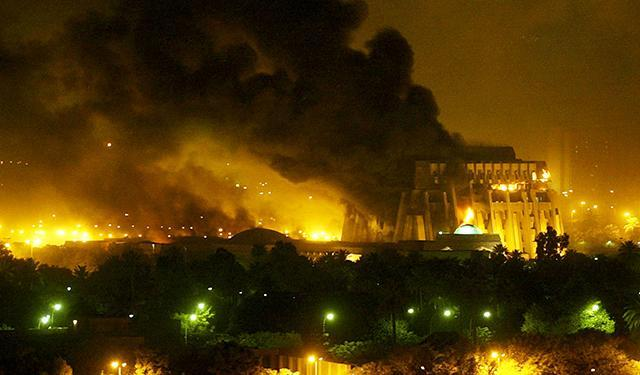 An explosion rocks Baghdad during air strikes March 21, 2003.