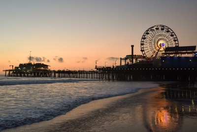 photo of the santa monica pier in the evening, featuring a large ferris wheel