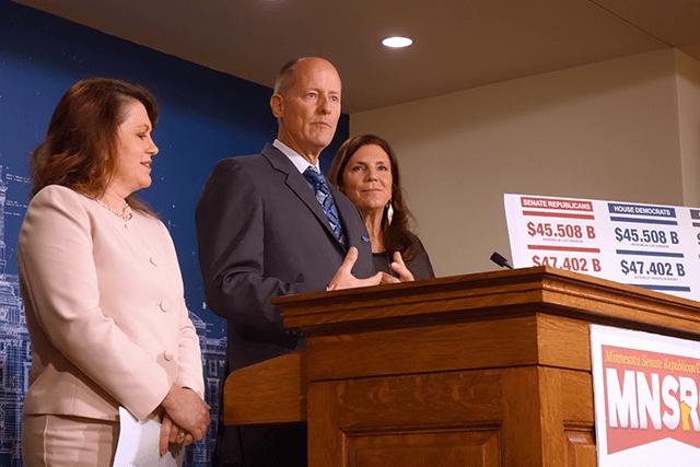 Senate Majority Leader Paul Gazelka, flanked by state Sen. Michelle Benson and state Sen. Julie Rosen