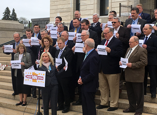 Senate Republicans shown after passing a bill to carry forward current spending levels into next budget. State Sen. Karin Housley is at the podium.
