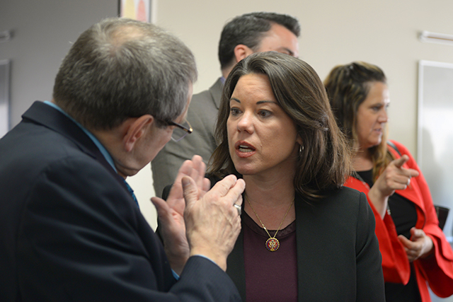 Rep. Angie Craig speaking with state Sen. Jim Carlson