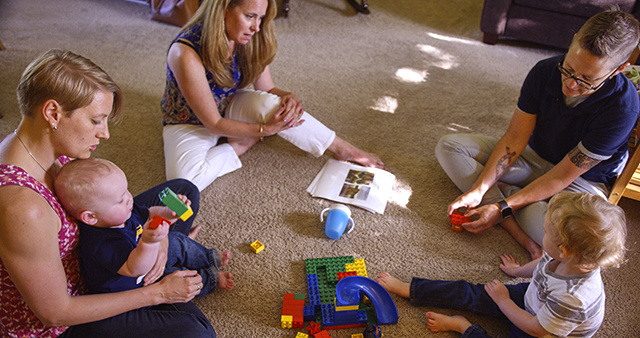 St. David's social worker Kate Dando, center, shown during a home therapy session with a foster family.
