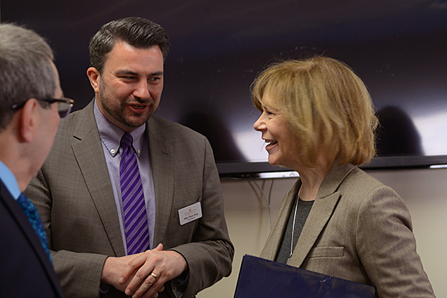 Sen. Tina Smith, right, speaking with Superintendent Peter Olson-Skog