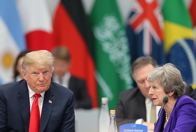 President Donald Trump speaking with Prime Minister Theresa May during the opening of the G20 leaders summit in Buenos Aires, Argentina, on November 30, 2018.