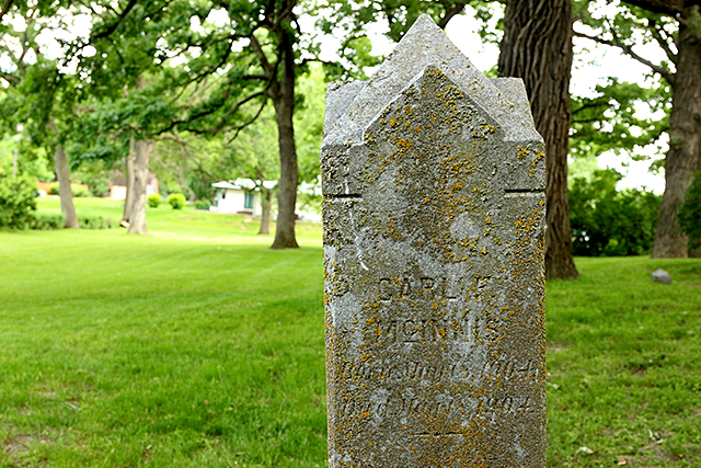 The grave stone for Carl McGinnis in the old St. Anthony Township Cemetery.