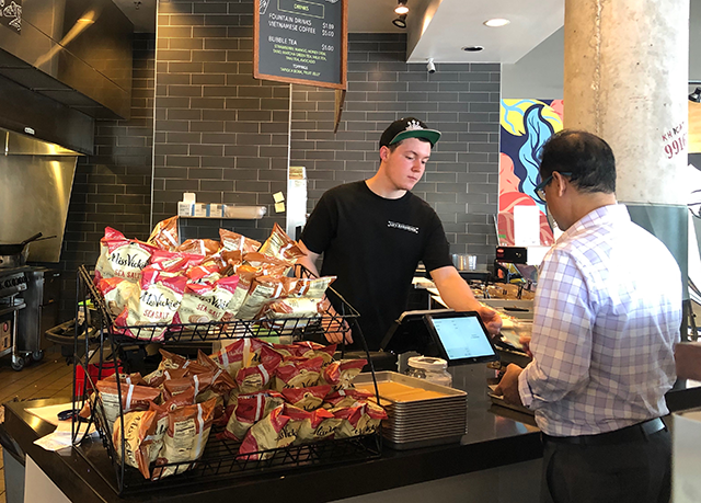 Lu's Sandwiches, a Minneapolis Bánh Mì shop, has seen positive results from the city's higher minimum wage requirements, owner Quaug Pham said.