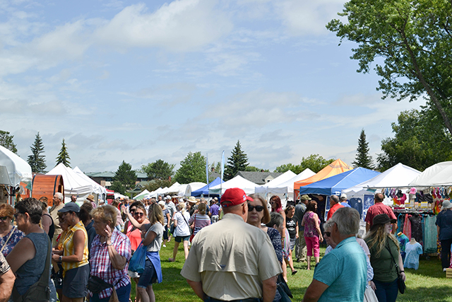 photo of people and tents at blueberry fest