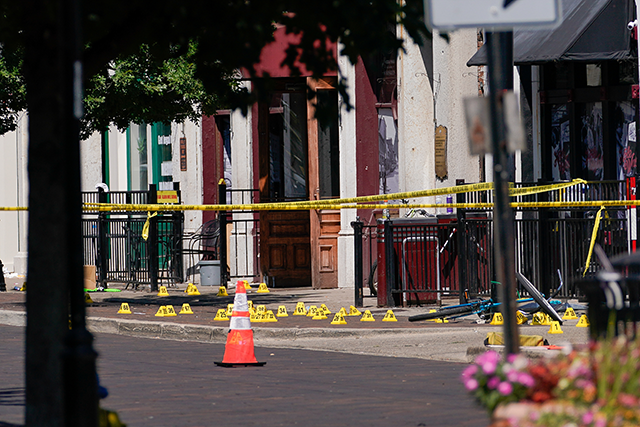 Evidence markers rest on the ground after a mass shooting