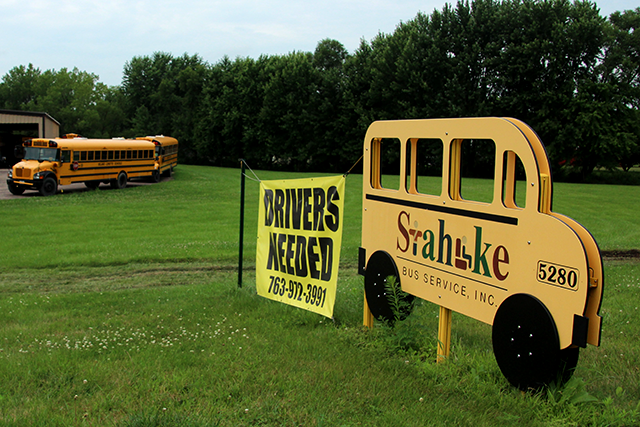 A sign in Delano promoting bus driver jobs.