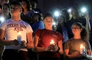 Mourners taking part in a vigil at El Paso High School