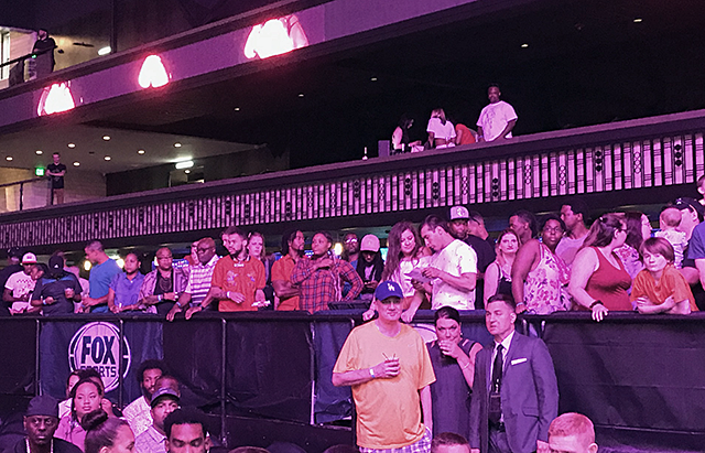 Fans pack the rails in front of the long bar for the Jamal James-Antonio DeMarco main event at an Armory fight card in July.