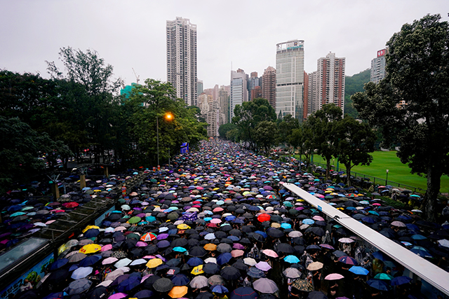 Anti-extradition bill protesters marching to demand democracy and political reforms in Hong Kong on Sunday.