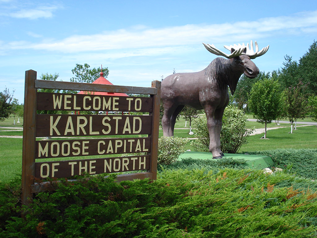 Signs in Karlstad welcome visitors to the Moose Capital of the North.