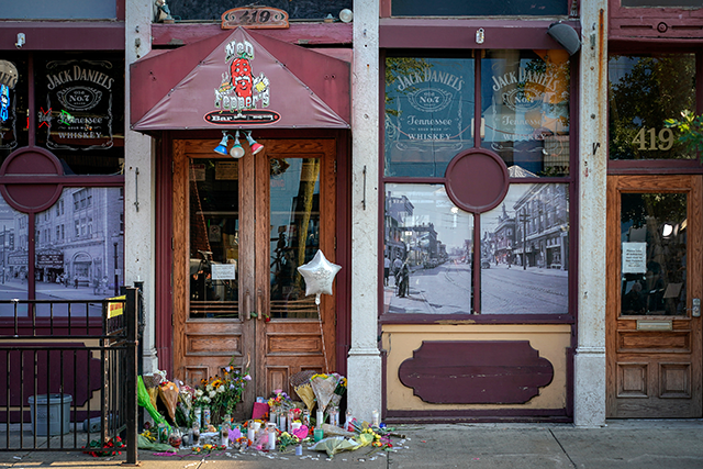A memorial fills the doorway in front of Ned Peppers Bar