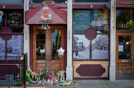 A memorial fills the doorway in front of Ned Peppers Bar