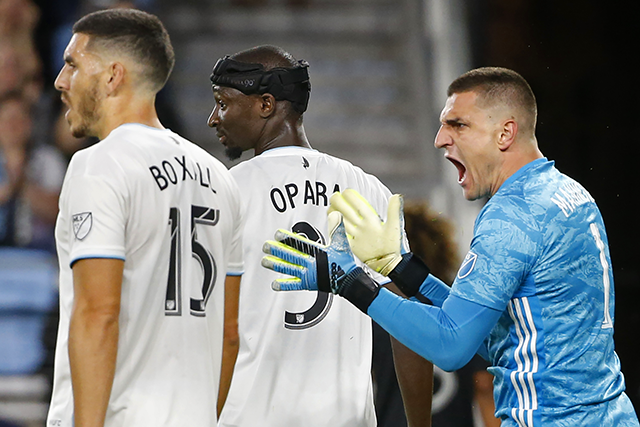 Minnesota United goalkeeper Vito Mannone, far right, cheers behind defender Michael Boxall and defender Ike Opara after making a save against Sporting Kansas City in the first half.