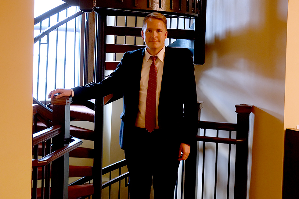 photo of christ schmitter on spiral staircase