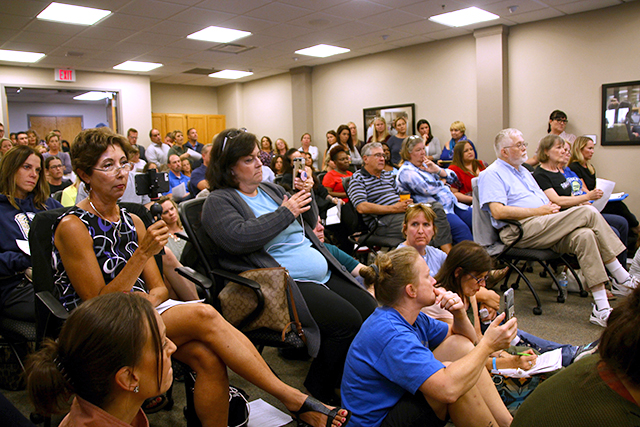 Attendees livestreaming the school board meeting Monday evening.