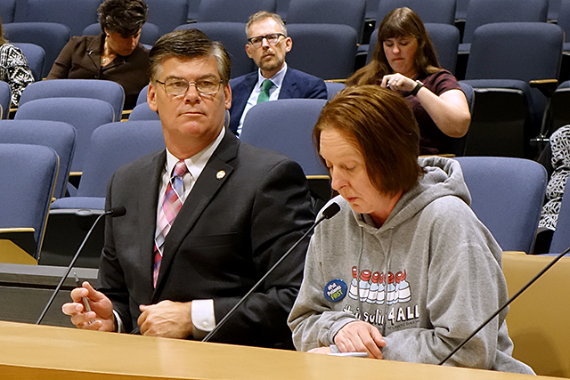 Nicole Smith-Holt testifying on Monday while bill sponsor Sen. Eric Pratt looks on.