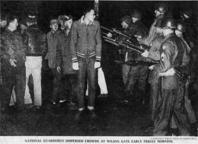 historical photo of national guard soldiers confronting strikers