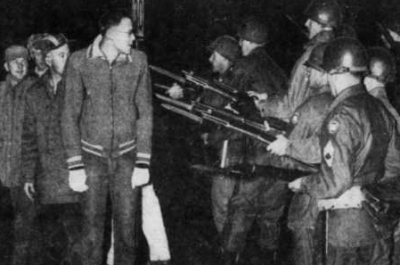historical photo of national guard troops confronting strikers
