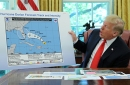 photo of president donald trump holding a chart of hurricane dorian's projected path