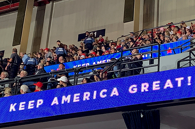 Police and Target Center security ousted several protesters who shouted and blew whistles at Trump from the arena rafters.