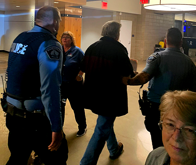 Police and Target Center security ousted a protester for holding an anti-Trump sign at Thursday's Trump rally in Minneapolis.