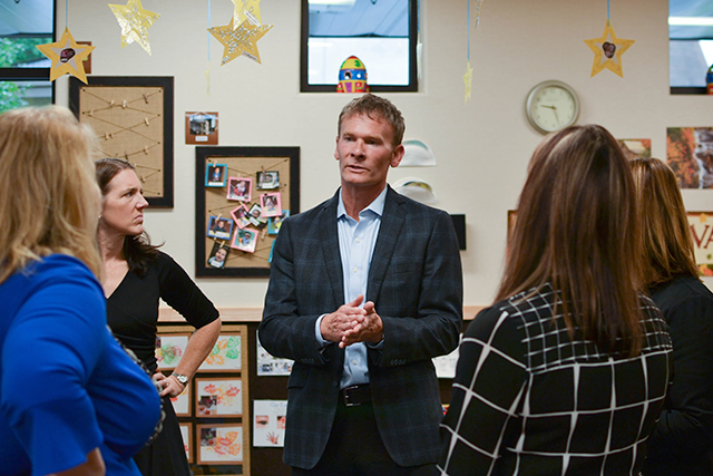 Chad Dunkley, center, president of the Minnesota Child Care Association and CEO of New Horizon, during last week's tour.