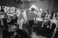 Patrons playing foosball and pinball at Moby Dick's