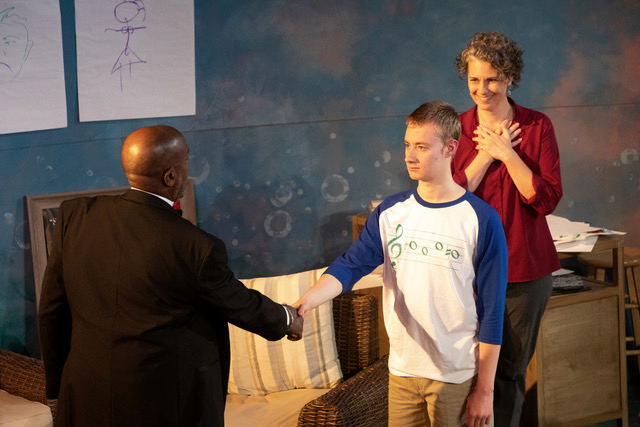 Lior (Sean Carroll) meets God (James A. Williams), as his mother Ella (Laura Stearns) looks on.