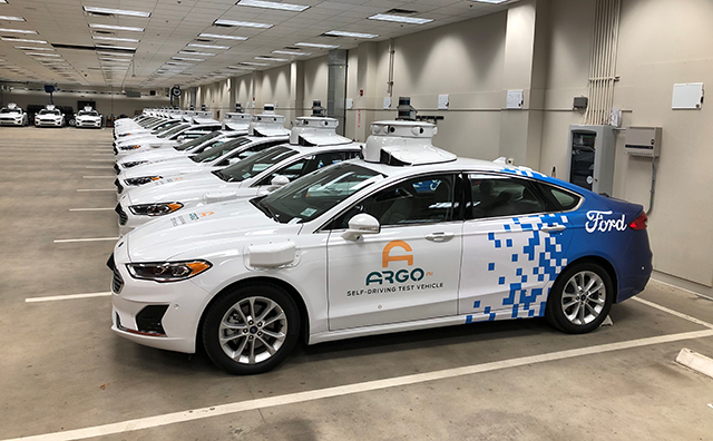 A row of Ford Fusion Hybrid sedans