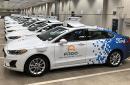 A row of Ford Fusion Hybrid sedans