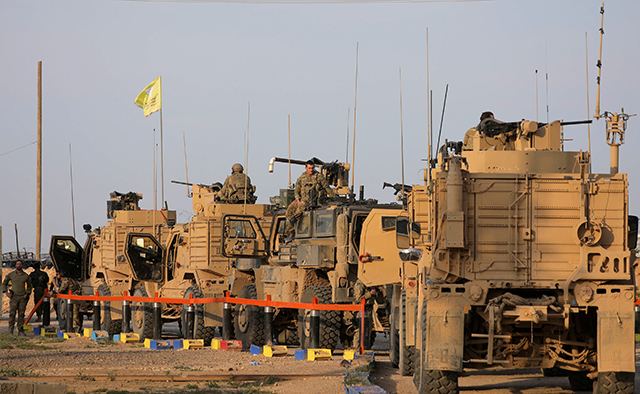 photo of military trucks in syria