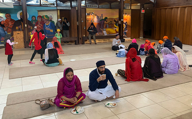 Worshippers at the Sikh Society of Minnesota ate their langar meals