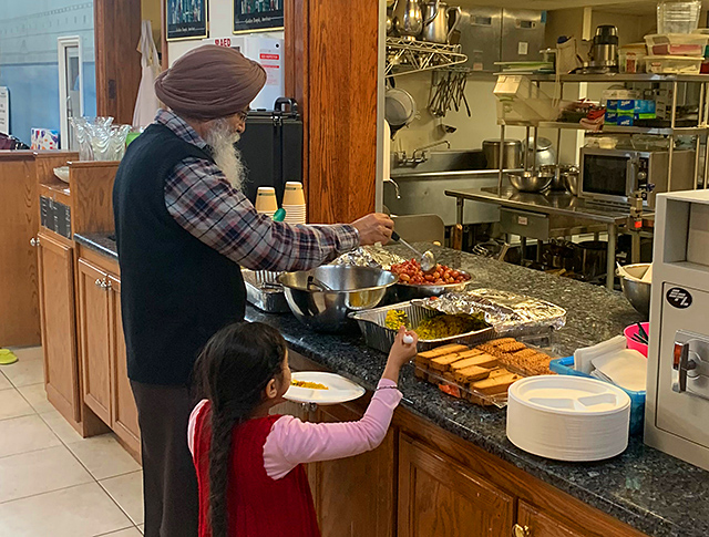 Worshippers at the Sikh Society of Minnesota dished up their langar meals