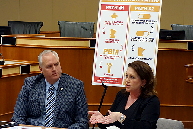 Sen. Sharon Benson, right, and Sen. Paul Anderson discussing options for reduced drug pricing for Minnesotans.
