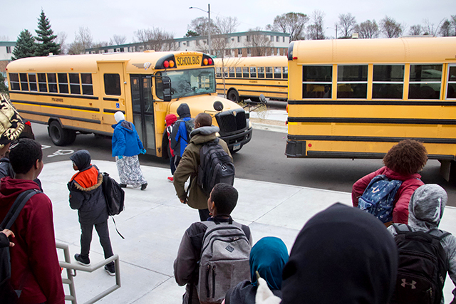 photo of students boarding school buses