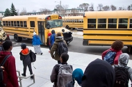 photo of students and school buses