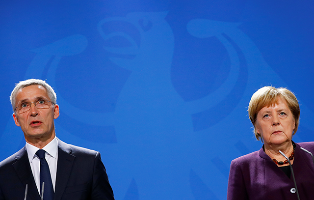 NATO Secretary-General Jens Stoltenberg and German Chancellor Angela Merkel