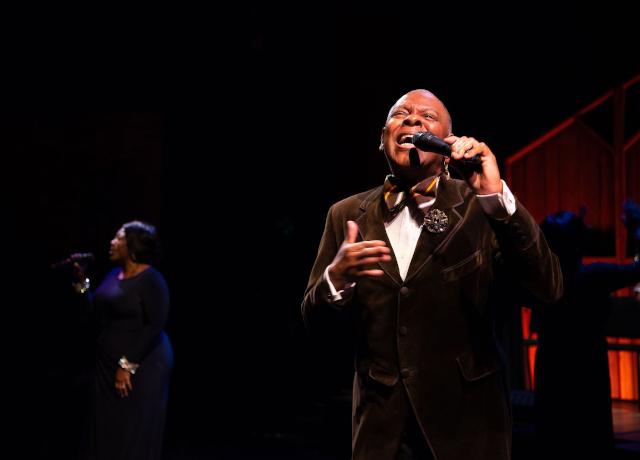 photo of man singing