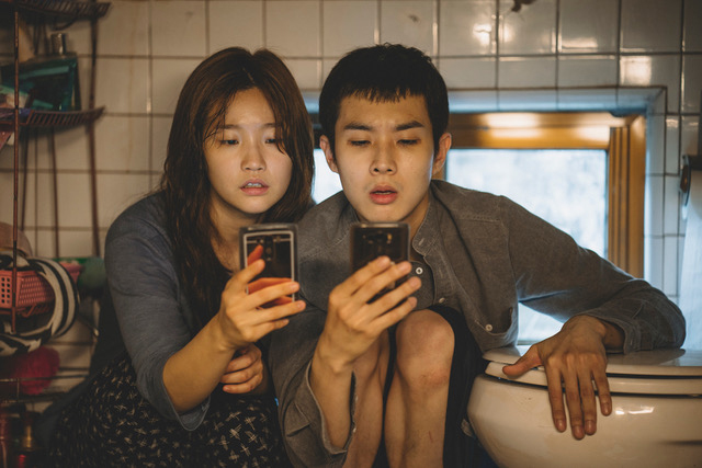 """So-dam Park and Woo-sik Choi in a scene from the movie """"Parasite."""""""