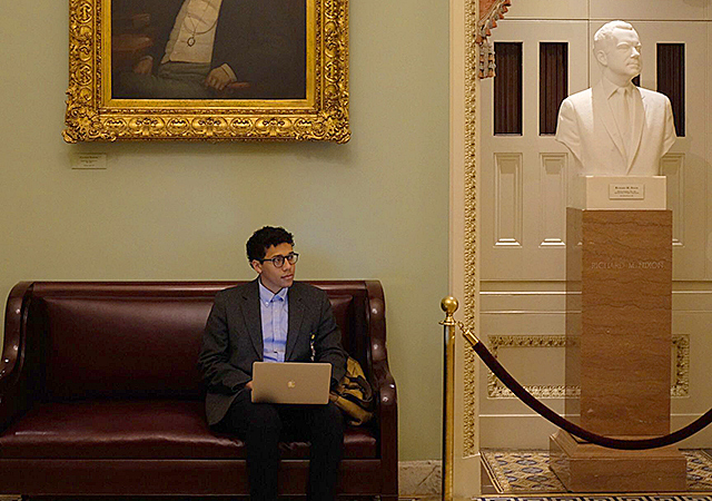MinnPost Washington correspondent Gabe Schneider working outside the Senate Chamber on Capitol Hill.
