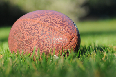 photo of football lying on field