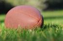 photo of football lying on field