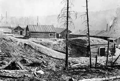 historical photo of a lumber camp