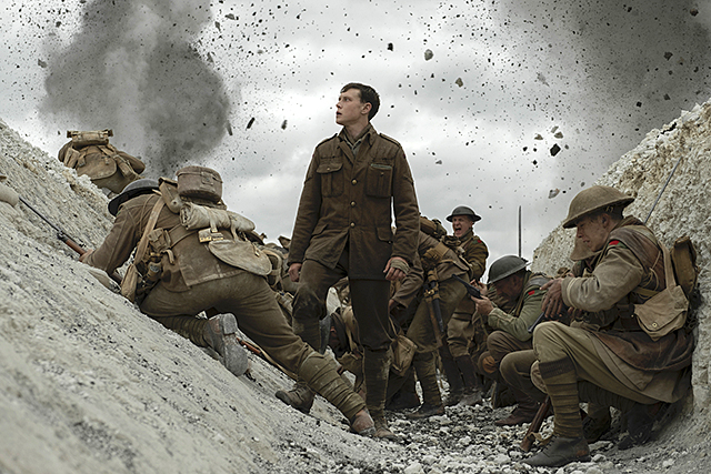 """George MacKay, center, as Schofield in """"1917."""""""