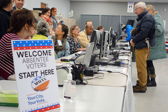 Voters began trickling in to the Minneapolis Early Vote Center upon opening at 8:00 Friday morning.