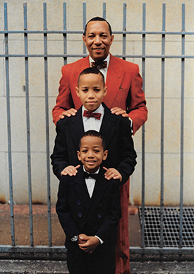 "Jamel Shabazz, ""Father and Sons, Harlem,"" c. 1990. Archival pigment print."