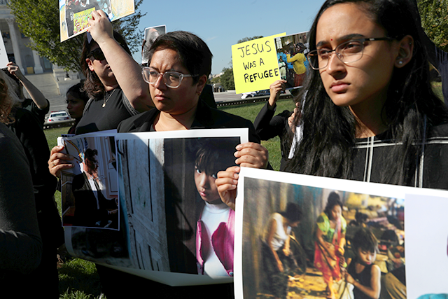 People protesting last October against the Trump administration cuts to the refugee resettlement program in front of the U.S. Capitol Building.
